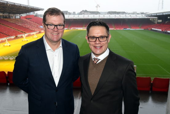 Rob Wicks, AFC commercial director, left ,and Courtney Marsh, CEO of the club's new health and wellbeing partner Health Shield.