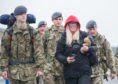 Emma Knutzen walks the final yards to RAF Lossiemouth with her son Jake.