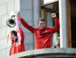 Scott Vernon lifts the trophy with Andy Considine during the celebration parade.