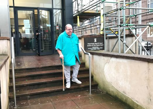 Gary Stevens leaves Peterhead Sheriff Court.