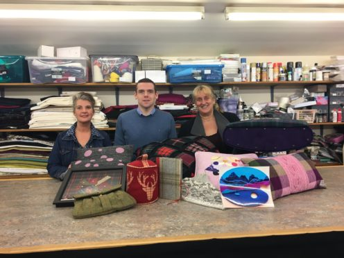 Douglas Ross with judges (from left)  Linda Stuart from Keith and Elaine Bruce from Eden Watermill, looking at the entries for the competition at the Keith Kilt