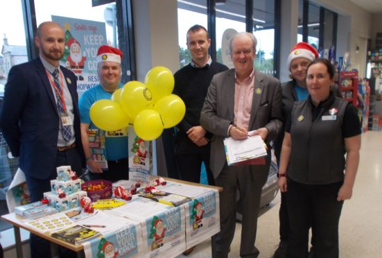 MSP Stewart Stevenson with Co-op managers, shopworkers and an USDAW area organiser during a visit to the Banff store this week