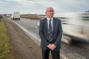 Fochabers Lhanbryde councillor Marc Macrae next to the A96 near Elgin.