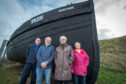 The newly-restored Harvest Reaper fishing vessel in Burghead with (L-R) - Peter Wilson (Senior Supervisor for Criminal Justice) Dan Ralph (Burghead Headland Trustee) Cath Miller (Secretary of Burghead Headland trust) and Hiliary Gloyer (Chair of Headland site)  Picture by Jason Hedges