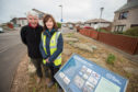 Ed McCann and Greenfingers Training Service officer Pam Lewis beside the Moray Sea School plaque