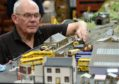 Dusty Millar from the Moray Model Railway Group demonstrates the display, which is modelled on the north-east of Scotland.