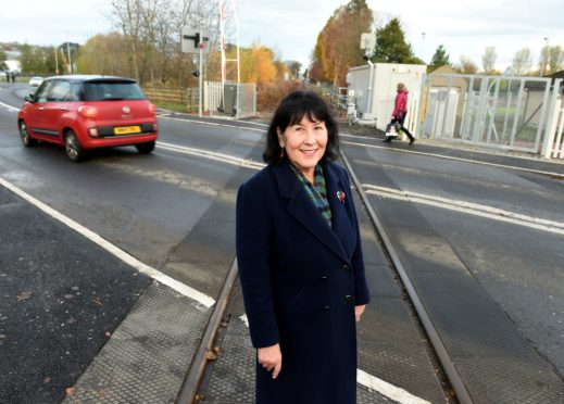 "Councillor Paterson says she is ""absolutely delighted"" with the improvements made to the communities level crossings."