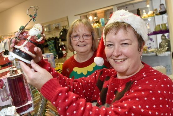 MSP Rhoda Grant visits the Highland Hospice charity shop in Queensgate to show what bargains you can pick up for less..