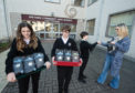 Students Alannah Ayres, Ben Cameron and Millan Ormsby sell rice at Speyside High School.