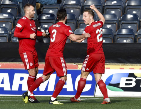 Bruce Anderson celebrates snatching a point for Aberdeen.