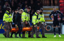 Liam Fontaine was stretchered off against Dundee United.