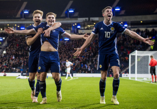 Ryan Christie celebrates with James Forrest and Stuart Armstrong on Tuesday night.