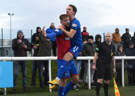 Shaun Rooney (left) celebrates his goal with Tom Walsh