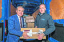 Richard Lochhead MSP and Fraser Maclean, general manager of Parcel Logistics at Menzies Distribution.