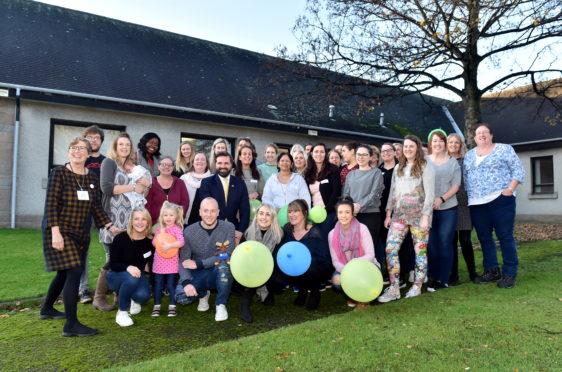 The Theraplay team pose with councillor John Wheeler