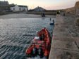 RNLI assisting with the removal of the car from the water on Saturday