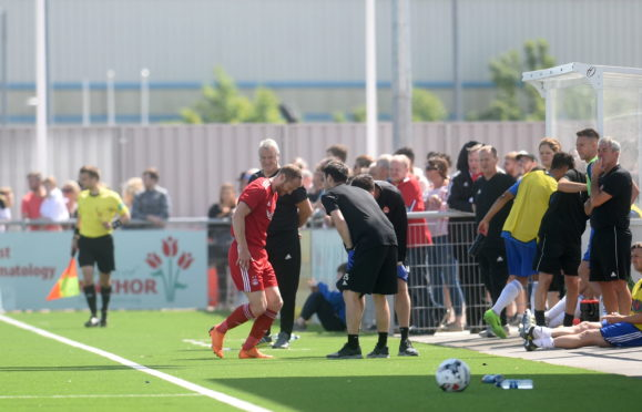 Mark Reynolds limps out of the pre-season friendly with Cove Rangers.