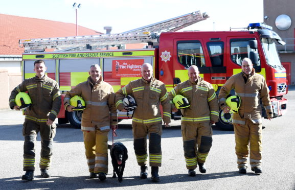 Six firefighters from the Peterhead Firestation Red Watch successfully completed a 75 mile walk from Peterhead to Dyce and back. Pictured are from left, Dean Peacock, Malcolm Cooper (with dog Buddy), Robbie Sturrock, Gary Collins and James Simpson.