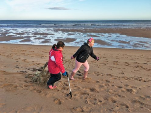 Two of the 17 young volunteers from Kininmonth Primary School clearing up Ugie Beach, Peterhead