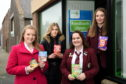 Pictured are from left Press and Journal reporter Tamsin Gray and Peterhead Academy pupils, Sanija Gorodko, Chelsea Duncan and Anna McAuslan. They completed the kettle food challenge to raise awareness for Peterhead foodbank. Picture by Darrell Benns