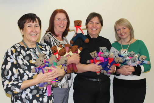 L-R: Democratic Services Manager, Moira Patrick; Committee Services Officer, Caroline Howie; Chief Inspector, Maggie Miller, and Committee Services Officer, Lissa Rowan with the trauma teddies