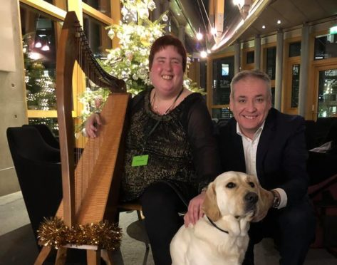 Fiona Kyle, Richard Lochhead MSP and Gus the guide dog