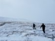 Hill walkers in soft snow on Glen Nevis at the weekend.