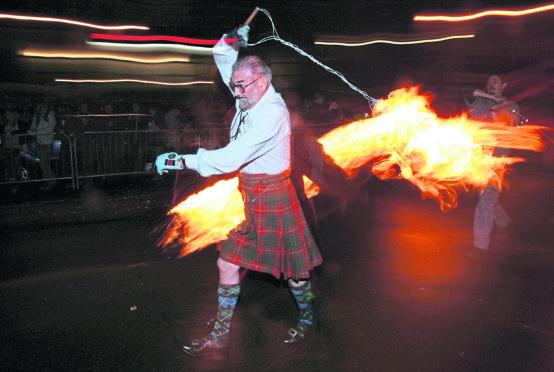 Revellers celebrate Hogmanay in Stonehaven.