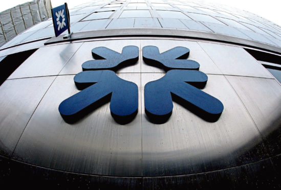 File photo dated 19/01/09 of the RBS logo outside a branch of the Royal Bank of Scotland on Threadneedle Street, London. Three British banks including part-nationalised RBS face paying more than 10 billion US dollars (£6 billion) to the US government under its new stringent tax regime on the sector, it was reported today. PRESS ASSOCIATION Photo. Issue date: Friday January 15, 2010. See PA story CITY Banks. Photo credit should read: Dominic Lipinski/PA Wire