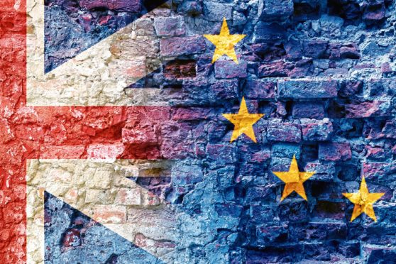 Brexit, flags of the European Union and the United Kingdom as overlay on an old brick wall of a ruin, politics background concept