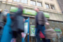 """Benefit claimants in Glasgow may have to travel further for employment services under UK government plans to close half the city's 16 job centres. The Scottish National Party described the proposal as """"morally outrageous"""". It said those from the poorest areas would face higher travel and phone costs, making it harder to seek work. The Department for Work and Pensions said the closures would save public money and reflected an increase in use of online and telephone services. Under the plans, there would be no job losses among Jobcentre Plus staff, while claimants would not have to travel further than four miles or 40 minutes. Denise Horsfall, DWP work services director for Scotland, said it was now easier for claimants to access Jobcentre services """"whether that be in person, online or over phone"""". """"By bringing together a number of neighbouring jobcentres we're continuing to modernise our operations while ensuring that our premises provide best value to the taxpayer,"""" she said. The DWP said there would be a pub"""