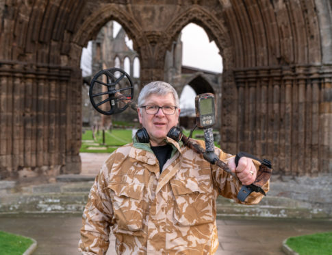 Alistair McPherson outside Elgin Cathedral.