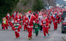 Hundreds of Santa's lined the streets of Aviemore for the 8th Annual Aviemore Santa Run.