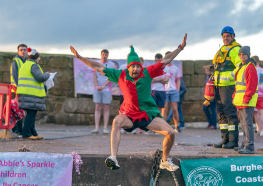 More than 100 swimmers took part in this year's Boxing Day swim at Burghead.