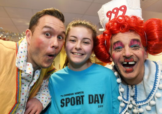 Stars from this year's panto visited the children at Royal Aberdeen Children's Hospital. Pictured is Milla Roy cor with leads, Muddles, Jordan Young left and Nurse MacDuff, Alan McHugh.