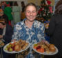 Ashleigh McWilliam serves lunch with a smile.