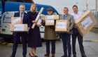 Richard Lochhead MSP, Fishbox director Fiona Houston, businessman Willie Cameron, Drew Hendry MP and Menzies Distribution general manager Fraser MacLean at the launch of the Highland Parcels delivery service.