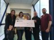 Jackie Hall raised £5,000 for Edinburgh Royal Infirmary in memory of her father. Pictured: Laura Mulholland, Jackie's daughter, Jack Mulholland, Laura's son, Jackie Hall, senior charge nurse Jo Stewart,  Jackie's partner Alan Finlay and clinical nurse manager Gordon Mills.
