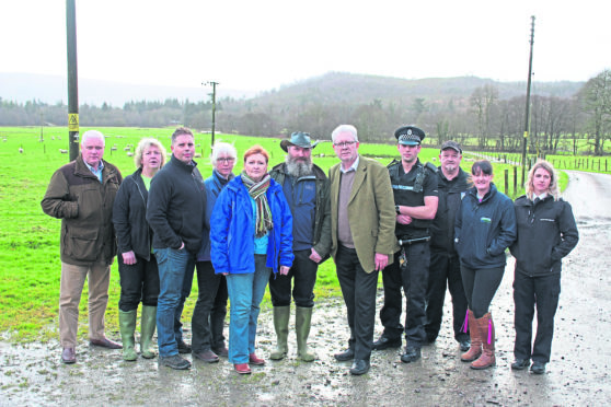 Farmer Brian Walker, with MSPs Mike Russell and Emma Harper and others involved in the meeting yesterday including police and SSPCA officers.