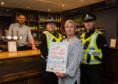 Police launch Ask for Angela campaig.  Pictured left to right: Marek Marusinex (Bar Manager) PC Nicola Curley, Joanne Larsen (Licensing Standards Officer for Moray Council) and PC Jad Leach
