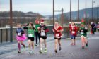 Participants tackle 2k fun run round Inverness College UHI in aid of charity.