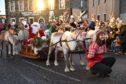 Banff reindeer parade making its way through the town.
