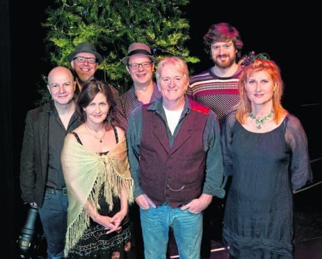 John McCusker, Karen Matheson, Ian Carr (back), Kevin McGuire (back), Phil Cunningham (front centre), Kris Drever and Eddi Reader.