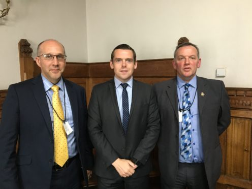 Calum Greenhow, chief executive of the National Federation of Subpostmasters, Moray MP Douglas Ross and Moray-based subpostmaster Paul McBain.