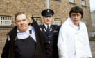 "Ronnie Barker, Richard Beckinsale and Fulton Mackay during location shooting for the film version of their TV series ""Porridge"" at Chelmsford Jail."