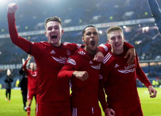 Scott Wright, Max Lowe and Lewis Ferguson celebrate at full-time at Ibrox.