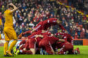 Aberdeen players mob Lewis Ferguson after his late winner.
