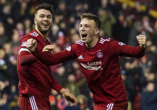 Connor McLennan and Lewis Ferguson celebrate after the latter's winner against Livingston.