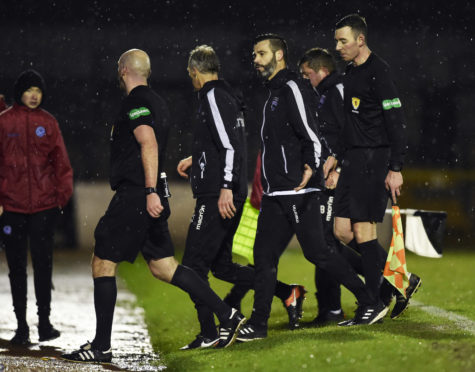 Ross County co-manager Stuart Kettlewell exchanges words with referee Bobby Madden at full time