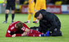 Aberdeen's Bruce Anderson receives treatment from the physio at Livingston.
